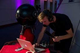 Ben Graney Green, junior aerospace engineering major, remixes live sound for the person inside the Soundware helmet. (Gabe Fernandez/Blog Photographer)