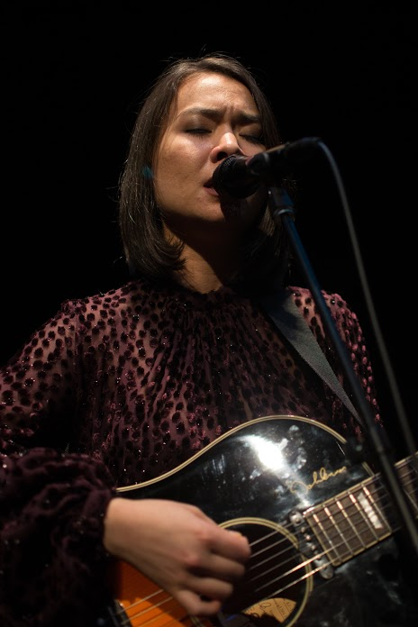 A graceful Mitski plays to a hushed room. Her guitar and her voice eclipsing the distant sounds of glasses clinking and the clack of camera shutters. (Joe Duffy/Bloc Reporter)