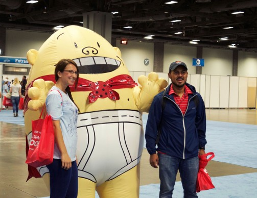 Talia Seriy, 33, and Frank Orellana, 29, both from Silver Spring, pose for a photo with the popular children's character, Captain Underpants at the National Book Festival in the Washington Convention Center Saturday, Sept. 24, 2016. (Jordan Stovka/Bloc Reporter)