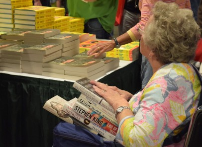 "Martha Gay, 70, travelled from her home in Downingtown, Pa. to attend the National Book Festival in D.C. Saturday Sept. 24, 2016 for a second year. Gay hand-selected a pile of six books to purchase, however assured that this haul was ""not as many as last year."" (Jordan Stovka/Bloc Reporter)"