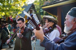 (from left to right) Paul Wells, Cathy Palmer, and Bill Palmer play instruments at the 40th annual Maryland Rennaisance Festival. (Josh Loock/Bloc Photographer)