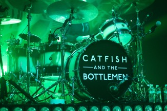Hidden behind the drums is fourth member of the band, Robert Hall. (Casey Tomchek/ Freelance Photographer)