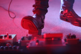 Guitarist, Johnny Bond, steps on a set of pedals during the performance. (Casey Tomchek/ Freelance Photographer)