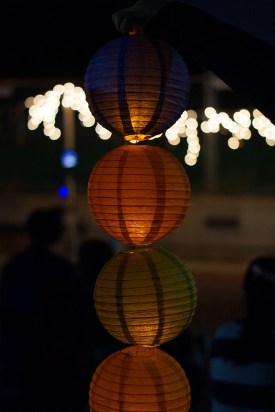 Lanterns being held during the festivities. (Heather Kim/Bloc Photographer)
