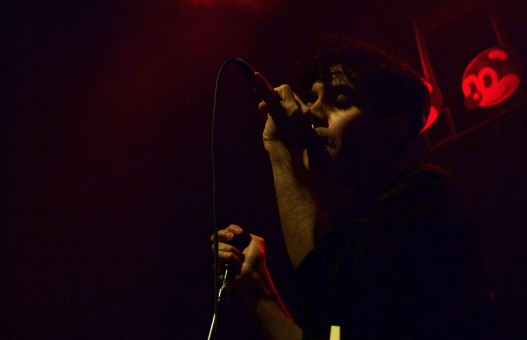 Neon Indian's Alan Palomo gets intimate with the music during the group's set at 9:30 Club Friday, Oct. 7, 2016. (Jordan Stovka/Bloc Reporter)