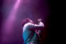 Michael Angelakos, the singer for Passion Pit, sings soulfully into the mic during his performance. (Julia Lerner/Bloc Photographer)