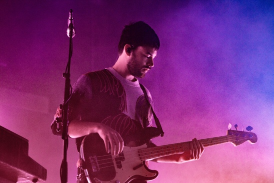 Bassist of The 1975, Ross MacDonald, performs at Eagle Bank Arena on Nov. 9. (Casey Tomchek/Freelance Photographer)