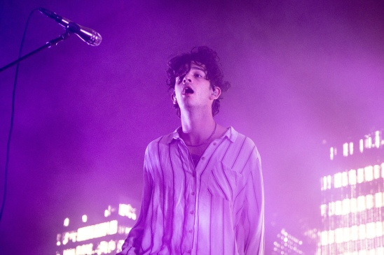 Matty Healy, frontman of The 1975, looks out into the audience during a performance at Eagle Bank Arena on Nov. 9. (Casey Tomchek/Freelance Photographer)
