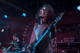Bassist of The Hunna, Jermaine Angin, peforms at U Street Music Hall on the Alt Nation Advanced Placement Tour. Pictured in back, drummer Jack Metcalfe. (Cassie Osvatics/Bloc Reporter)