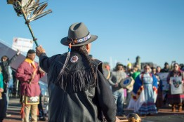 """Gray Michael Parsons chant to the crowd at the end of the march, the crowd responding with """"water is life."""" (Cassie Osvatics/Bloc Reporter)"""