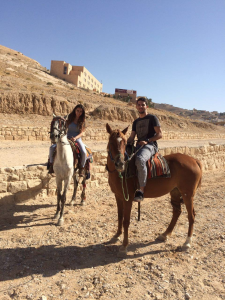 Aiyah Sibay and her fiancé ride horses in Jordan. (Photo courtesy of Aiyah Sibay)