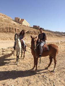 Aiyah Sibay and her fiancé ride horses in Jordan. (Photo courtesy of Aiyah Sibay)