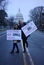 Lily Ha (left) and Emily Gorey, freshmen from College Park, pose in front of the Capitol before they leave to join over 500,000 others. (Heather Kim/Bloc Photographer)
