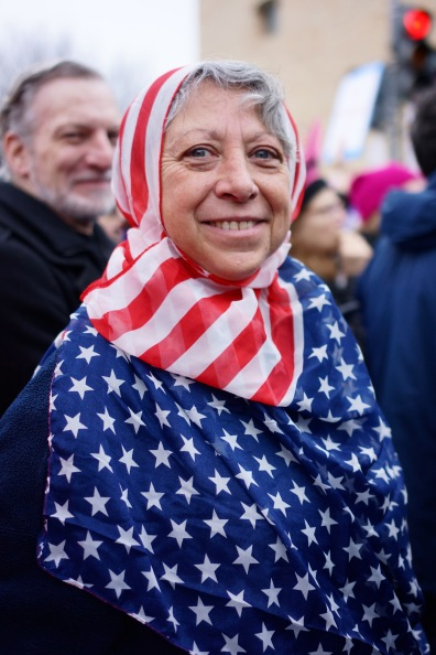 A University of Maryland almuni, adorned in an American flag hijab, poses for a quick portrait. (Heather Kim/Bloc Photographer)