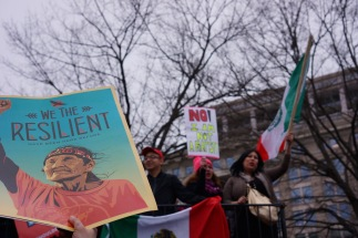 Protesters are seen waving the Mexican flag behind a sign that displays resilience. (Heather Kim/Bloc Photographer)