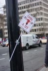 Another lone sign left behind and taped to a lamppost. (Heather Kim/Bloc Photographer)