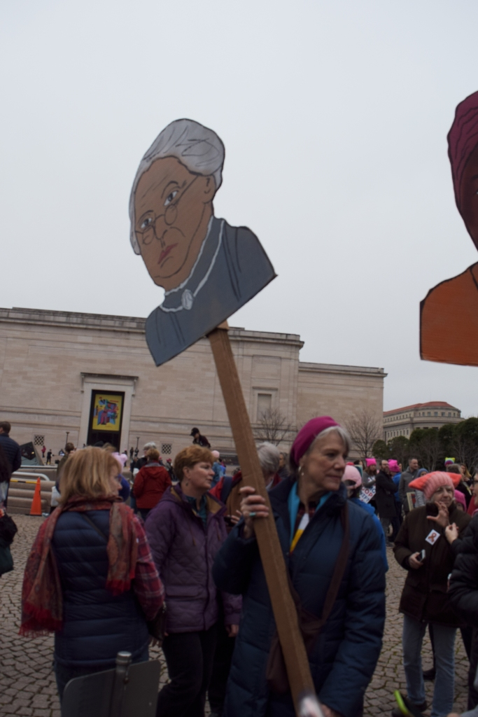 Nancy Strauss, 70, stood in a line with women holding up posters of historical women. (Maya Pottiger/Editor-in-Chief)