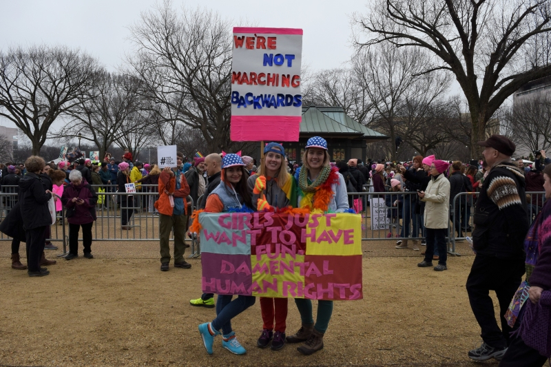 (Left to right) Rachel Roza, 30, Alese Russel, 28, and Kate Russel, 30, all traveled from Cleveland because they are worried about their own freedom, as well as the freedom of those they love. (Maya Pottiger/Editor-in-Chief)