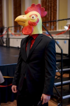 A member of CSA wears a rooster mask in celebration of the Year of the Rooster. (Heather Kim/Bloc Photographer)