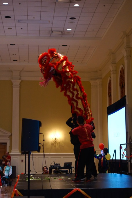 The Lion Dance team from Columbia, Maryland performed highly entertaining stunts that had the room in a constant fit of laughter and a feeling of awe. (Heather Kim/Bloc Photographer)