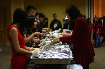 The banquet was complete with multiple tables of delicious and traditional Chinese food, served by helpful CSA members. (Heather Kim/Bloc Photographer)