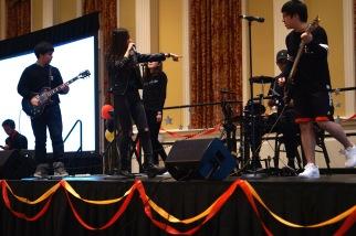 Band members of Naga enjoying themselves as they perform. (Heather Kim/Bloc Photographer)