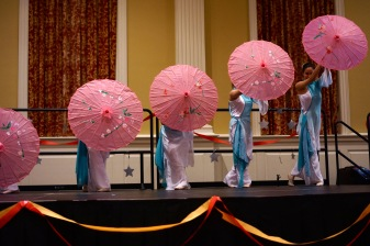 The team was a sight to behold as they had brightly colored umbrellas and outfits. (Heather Kim/Bloc Photographer)