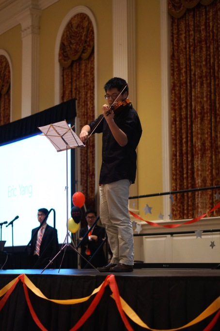 Performer, Eric Yang, played a traditional Chinese song on his violin for the event. (Heather Kim/Bloc Photographer)