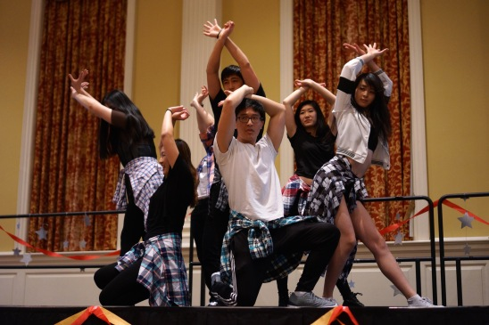 Some members of G-girls & the Wasabi Boyz, a dance team at UMD that does covers of dances from various Asian music groups along with self-made choreography, ends their performance with a team pose. (Heather Kim/Bloc Photographer)