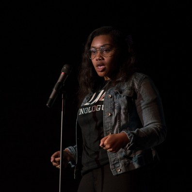 "Freshman Global International Studies major Ashley Edwards performs her piece ""Corners"" during Black Monologues in the Hoff Theater. (Cassie Osvatics/Bloc Reporter)"