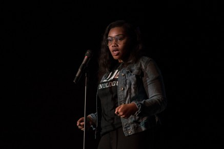 """Freshman Global International Studies major Ashley Edwards performs her piece """"Corners"""" during Black Monologues in the Hoff Theater. (Cassie Osvatics/Bloc Reporter)"""