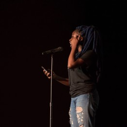 Freshman Tomi Ajiboye performs at Black Monologues in the Hoff Theatre. (Cassie Osvatics/Bloc Reporter)