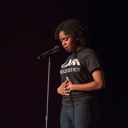 "Gislaine Hoyah performs her poems ""Again"" and ""Mourning Sickness"" at Black Monologues in the Hoff theatre. Hoyah is a sophomore community health major with a minor in creative writing. (Cassie Osvatics/Bloc Reporter)"