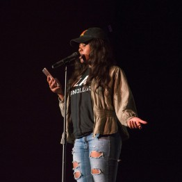 Mary Uwadineke, a senior food science major and global poverty minor, performs an untitled poem at Black Monologues in the Hoff Theatre. (Cassie Osvatics/Bloc Reporter)