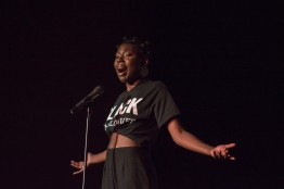 "Maud Acheampong, a freshman neurobiology and physiology major performs at Black Monologues in the Hoff Theatre. Acheampong read two poems entitled ""1856"" and ""Crack,"" the first of which tells the story of Margaret Garner from Garner's perspective after she was captured. (Cassie Osvatics/Bloc Reporter)"