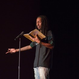 "Jaelen Barnett, a first years masters student of minority and urban education peforms his poems ""Divine"" and ""November 8, 2016."" (Cassie Osvatics/Bloc Reporter)"