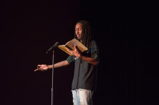 """Jaelen Barnett, a first years masters student of minority and urban education peforms his poems """"Divine"""" and """"November 8, 2016."""" (Cassie Osvatics/Bloc Reporter)"""