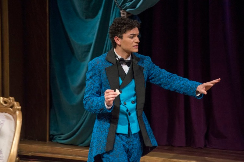Montana Monardes performs as Algernon Moncrieff during the dress rehearsal for The Importance of Being Earnest in the Kogod Theatre. Monardes is a junior theater major and the Co-ArtisticDirector of Kreativity. (Cassie Osvatics/Bloc Reporter)