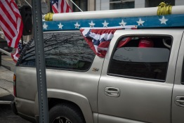 """Rob Cortis, one of the main organizers of the event and driver of the """"Trump Unity Bridge,"""" sits in his truck waiting to lead the march to the White House. Saturday, March 25, 2017. (Josh Loock/Bloc Photographer)"""