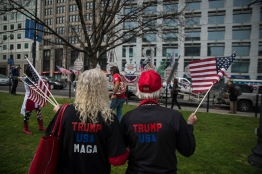 "Ruth and Loude Adkins look on at the ""Trump Unity Bridge"" before following it down 17th St. NW. to the White House. The Adkins came from Gastonia, North Carolina to show their support for the President on Saturday, March 25, 2017. (Josh Loock/Bloc Photographer)"