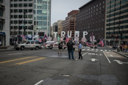 """The """"Trump Unity Bridge,"""" towed by a truck, along with the demonstrators of the 'MAGA March,' begin their journey to the White House after police shut down a portion of 17th St. NW. on Saturday, March 25, 2017. (Josh Loock/Bloc Photographer)"""