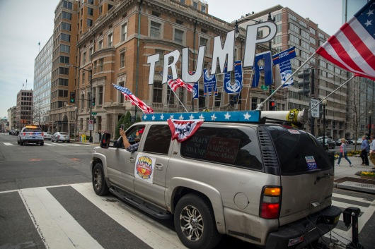 "Rob Cortis, one of the main organizers of the event, drives his ""Trump Unity Bridge"" towards the White House on Saturday, March 25, 2017. The event was held as a sign of support for The President. (Josh Loock/Bloc Photographer)"