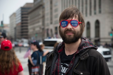 "Tom, a Trump supporter, wears his ""Make America Great Again"" sunglasses on the pavement outside of the White House in Washington, D.C., Saturday, March 25, 2017. He declined to give his last name. (Josh Loock/Bloc Photographer)"