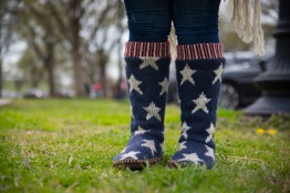Rosalie Schissler wears star-spangled boots near the Washington Monument after participating in the 'MAGA March' on Saturday, March 27, 2017. Rosalie, along with other attendees, gathered in near the White House to show their support for President Trump. (Josh Loock/Bloc Photographer)