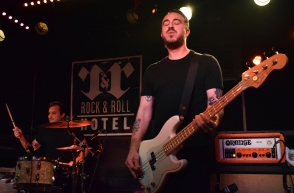 Menzingers' bassist Eric Keen sighs of relief during the band's sold-out show at D.C.'s Rock And Roll Hotel, Wednesday, March 29, 2017 (Jordan Stovka/Bloc Reporter).