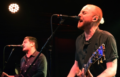Greg Barnett (left) and Tom May (right) of Scranton, Pa. punk-rock group The Menzingers play in front of a sold out audience Wednesday, March 29, 2017. (Jordan Stovka/Bloc Reporter).