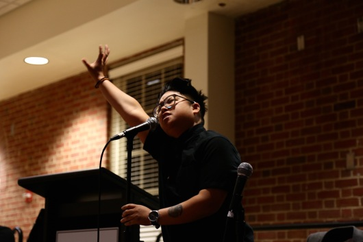 Kay Ulanday Barrett, a published spoken word poet, performs a set of poems speaking to the experiences of gender, ethnicity, and ableism. (Heather Kim/Bloc Photographer)