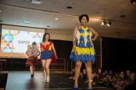 Imani Cabassa, a junior at the University of Maryland, shows off her blue and yellow condom outfit. Behind her is Tara Saideman, a senior in kinesiology, and Catherine Cassell, a freshman physics major. (Josh Loock/Bloc Photographer)