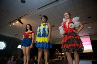 (from left to right) Tara Saideman, a senior in kinesiology, Imani Cabassa, a junior at the University of Maryland, and Catherine Cassell, a freshman physics major, wear their condom outfits at the edge of the runway as the Condom Fashion Show comes to an end. (Josh Loock/Bloc Photographer)