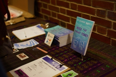 "Barrett's book, ""When the Chant Comes,"" being displayed and ready to be sold to interested audience members after the show. (Heather Kim/Bloc Photographer)"